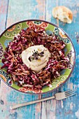 White bean purée on a bed of radicchio