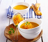 Papaya and carrot soup with carrots straw