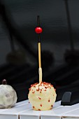 A white chocolate praline on a stick