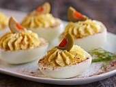 Devilled eggs garnished with olives