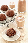 Chocolate nut truffles and glasses of cocoa