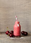 A cherry and coconut smoothie with cherries