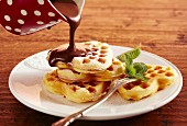 Heart-shaped waffles with rum and chocolate sauce