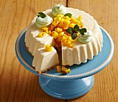 A mini creamy cheesecake with spicy mango salsa