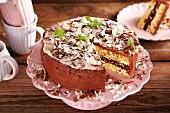 Sponge cake with peanut and chocolate cream