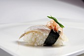 Nigiri sushi with fish, nori and ginger