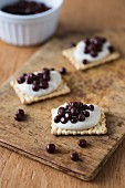 Biscuits with chocolate caviar and cream