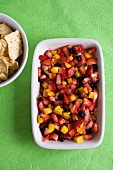 Fruit salsa and a bowl of corn chips