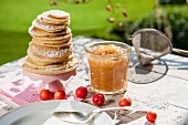 Apple sauce and pancakes on a garden table