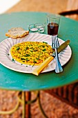 Herb omelette with bread and red wine