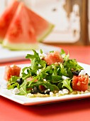Amaranth salad with watermelon, rocket and olives