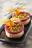 Mini cheesecakes with red fruits, physalis and pistachios