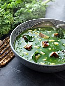 Green kale soup with bacon and white beans