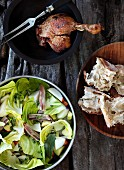 A cabbage medley with bacon, roast chicken and bread