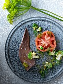Veal tongue with Romanesco florets, dill and tomatoes