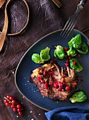 Pork belly with redcurrants and Brussels sprouts