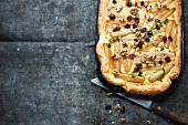 Black salsify tart with cranberries and walnuts