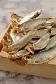 Smoked sprats on a wooden crate