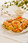 Quark pastries, vanilla fruit pastries, poppyseed pastries and a stewed plum pastry