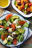 Avocado salad with grapefruit, and a roast vegetables salad with olives