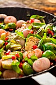 Fried Brussels sprouts with basil, onions and pomegranate seeds