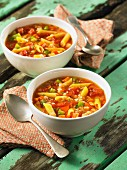 Minestrone soup with spring vegetables and penne pasta