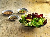 Three dressing for a winter salad: potato dressing, pear and walnut dressing, and a Parmesan dressing with olives and garlic