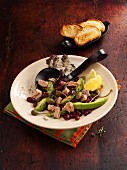 Avocado and tuna fish salad with kidney beans and caper fruits