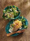 Baked potatoes with shrimps, frisee lettuce and water cress