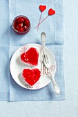 Cherry panna cotta with cherry sauce and grated coconut