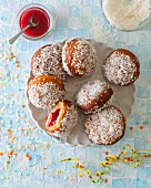 Doughnuts with coconut flakes and jam