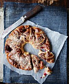 A bread wreath with blackberries and lingonberries
