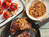 Roast beef with roast onions with oven-roasted tomatoes