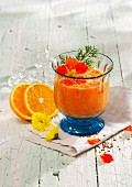 Orange and peach smoothie with carrot juice, orange juice and ginger
