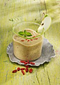 A banana and apple smoothie with yoghurt and goji berries