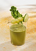 A kale and mango smoothie with grapes and apple juice