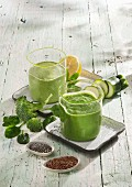 Green smoothies: a broccoli and apple smoothie and a spinach and kiwi smoothie