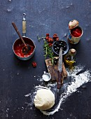 Pizza dough and assorted pizza ingredients