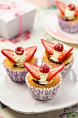 Butterfly cupcakes with strawberries