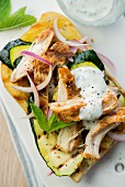 Chicken bruschetta with courgette and onions
