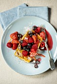 French toast with raspberries, lingonberries and strawberries