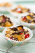 Muesli cakes with chocolate and candied fruits