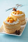Vol-au-vents filled with spiced compote and orange cream