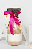 A baking mixture for oat biscuits in a glass bottle as a gift