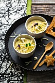 Cauliflower and potato soup with cheese, cream and white wine served with toast