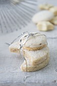 Vanilla biscuits and star anise biscuits tied with tinsel