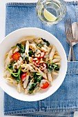 Penne with spinach, blue cheese, tomatoes and pine nuts