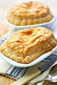 Beef pies with puff pastry lids