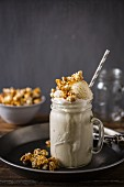 A milk shake with ice cream and caramelised popcorn