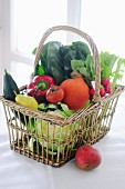Fresh vegetables and fruit in a shopping basket